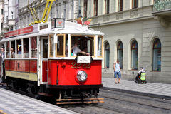 Red tram at old street in Prague. Stock Images
