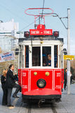 Red tram with passengers entering at the Taksim Stock Images