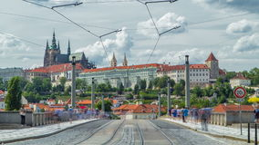Red tram passing on Manes Bridge timelapse Manesuv Most and famous Prague Castle on the background in Prague, Czech stock footage