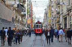 Red Tram and people stock image