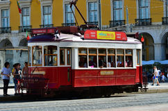 Red tram on a square Praca de Comercio in Lisbon, Portugal Royalty Free Stock Photos