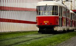 Red tram at the stop in the european city stock photography