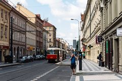 Red tram in the street of Prague. Prague,  Czech Republic - August 21, 2017: View of city street with red tram and buildings against sky Royalty Free Stock Photo