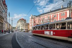Red tram in the street of Prague. Prague,  Czech Republic - August 21, 2017: View of city street with red tram and buildings against sky Stock Photo