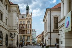 Red tram in the street of Prague. Prague,  Czech Republic - August 21, 2017: View of city street and buildings in historic city centre against sky Stock Image