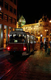 Red tram on street in Prague at night Royalty Free Stock Images
