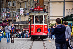 Red tram on Taksim Istiklal Street. ISTANBUL, TURKEY - APRIL 14 : Red vintage tram on Taksim Istiklal Street on April 14, 2013 in Istanbul, Turkey. Taksim Stock Photo