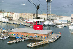 Red tram of tourists look at view of Estacio Maritima, Port Vell the (Old Harbour) of Barcelona, Spain Stock Images