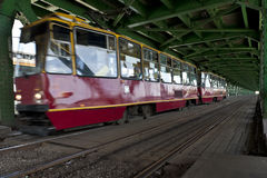 Red tram in Warsaw on old bridge Stock Photos