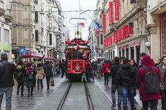 Red tramway on Istiklal Street in Istanbul, Turkey. December 30, 2017. Red tramway and crowded people on Istiklal Street in Istanbul, Turkey. December 30, 2017 Stock Photos