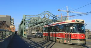 Red transit vehicle on the Queen Street Bridge in Toronto 4K. A Red transit vehicle on the Queen Street Bridge in Toronto 4K stock footage
