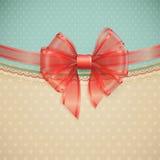 Red transparent bow on vintage background