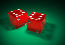 Red transparent dice on green surface Stock Photography