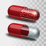 Red and transparent pills. Stock Image