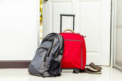 Red travel bag , backpack and shoes Stock Photography