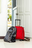 Red travel bag , backpack and shoes Stock Images