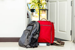 Red travel bag , backpack and shoes Royalty Free Stock Photo