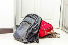 Red travel bag , backpack and shoes Royalty Free Stock Photography
