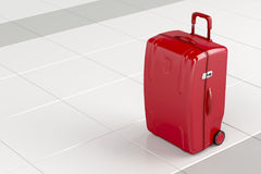 Red travel bag. On tile floor Royalty Free Stock Images