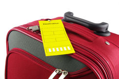 Red travel case and yellow information label Stock Images