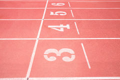 Red treadmill at the stadium. With the numbering from three fourth five six Royalty Free Stock Photography