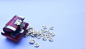 Red treasure chest with silver hearts spilling out. Silver hearts saying I love you spilling out of red treasure chest Royalty Free Stock Photography