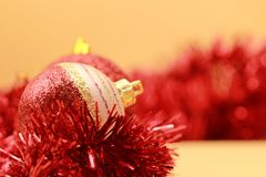 Red balls close up and Christmas Tree ornaments royalty free stock images