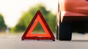 Red triangle of a car Stock Photo
