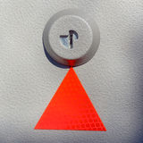 Red triangle on textured metal Stock Image