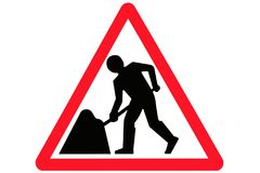 A red triangular men at work road sign stock image