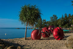 Red tricycle on the beach Royalty Free Stock Photos