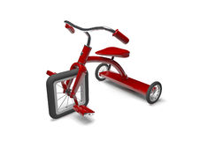Red tricycle with design flaw. Shiny red children's tricycle with square front wheel on white background Royalty Free Stock Photo