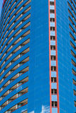 Red Trim on Blue Glass Hotel Royalty Free Stock Image