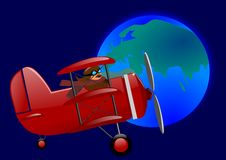 Red triplane and the globe Royalty Free Stock Image