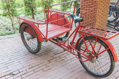 Red trishaw for transportation. In parking Stock Images