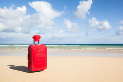 Red trolley in the sand. Travel background with a red trolley at a white and lonely beach, playa de Sotavento de Janida, Fuerteventura, canary islands, Spain Royalty Free Stock Photos