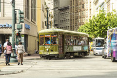 Red trolley streetcar on rail Stock Photo