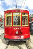 Red trolley streetcar on rail in New Orleans French Quarter. Red trolley streetcar on rail in New Orleans in the French Quarter stock photography