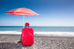 Red trolley under a sunshade Royalty Free Stock Photos