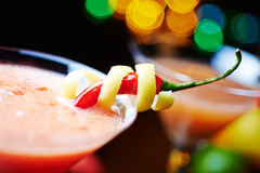 Red tropical alcohol cocktail or lemonade with decoration. Royalty Free Stock Images