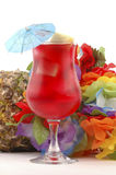 Red Tropical Drink. With colorful lei and pineapple Royalty Free Stock Photos