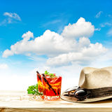 Red tropical drink and green mint leaves. Summer holidays Royalty Free Stock Photo