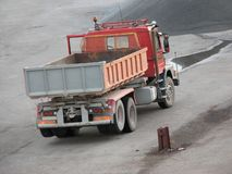 Red truck. Standing at the construction site waiting for gravel load Royalty Free Stock Photography