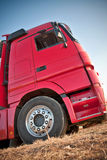 Red truck. Big, red truck parked in the field waiting for loading goods Stock Photography