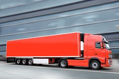 Red truck. Red semi truck in the city Royalty Free Stock Image