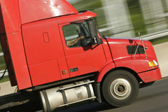 Red Truck. Close-Up of red truck cab speeding down highway in late afternoon sun stock photography