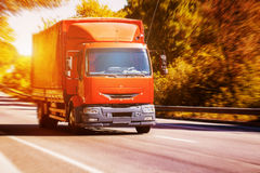 Red truck on blurry asphalt road Royalty Free Stock Images
