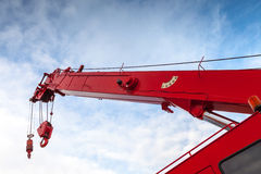 Red truck crane boom with hooks and scale weight Royalty Free Stock Images