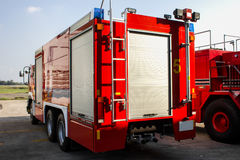 Red truck firefighter automobiles at airport Stock Photos