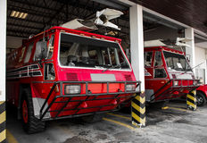 Red truck firefighter automobiles at airport Royalty Free Stock Images